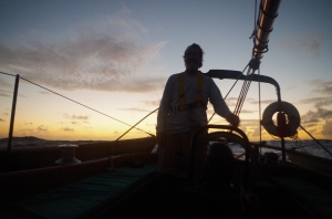 Nat Benjamin on dawn watch aboard Charlotte in the Windward Passage